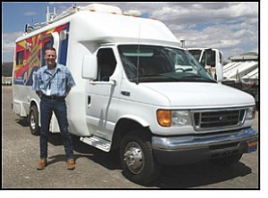Mike Browning, assistant emergency services coordinator, stands next to the TOAD 1 Communication Unit Thursday. The vehicle is jointly owned by Mohave County and the state of Arizona.