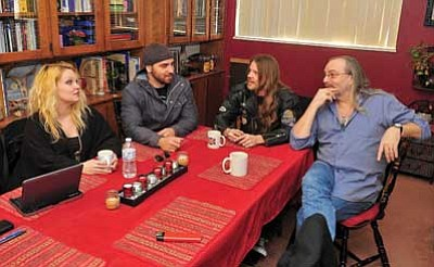 Matt Hinshaw/The Daily Courier<br> Stevie Thunder, middle left, and Dylan Doherty of Storm of Perception talk with Tru-B-Dor Records owners Heather Vincent-Niven and Alan Niven about their upcoming CD release party, Tuesday afternoon in Prescott.