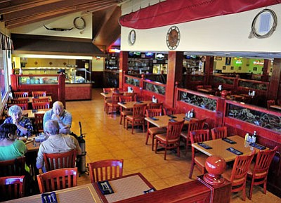 Patrons enjoy an early dinner at the Prescott Steak House Wednesday afternoon. (Photo by Matt Hinshaw/The Daily Courier)