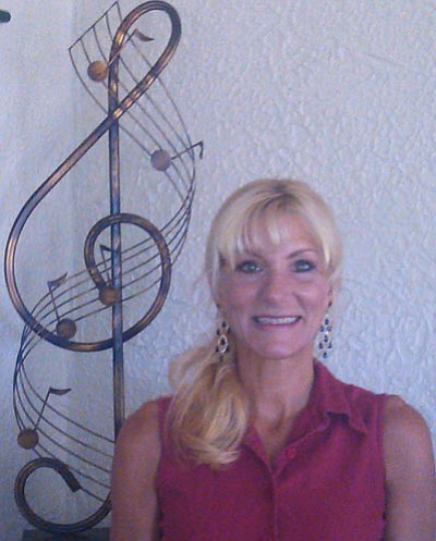 """Courtesy photo<br> Denise Roggio will perform her new song, """"Yarnell Rising,""""  Monday in front of the Yarnell Market as part of the town's Labor Day weekend celebration."""