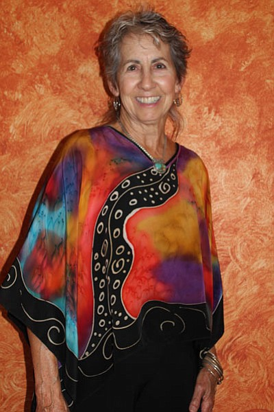 Courtesy photo<br> Mary Kaye O'Neill shows off one of her hand-painted silk tunics, available at 'Tis Art Center and Gallery, 105 S. Cortez St. in Prescott.