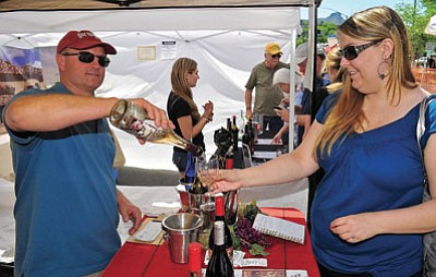 John McLoughlin, winemaker and owner of the Jerome Winery pours a glass of Honey Mead for Heather Wood of Phoenix.