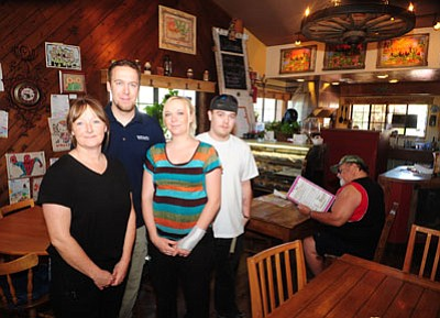 Les Stukenberg/The Daily Courier<br>It's a family affair with the new owners of the Prickly Pear Café in Prescott Valley, from left, Corrina Coulter, Christopher Hollingsworth, Natasha Hollingsworth and Andrew Coulter.
