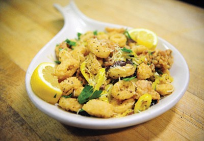 Papa's Calamari Sicilian-style dish.<br>  Les Stukenberg/The Daily Courier