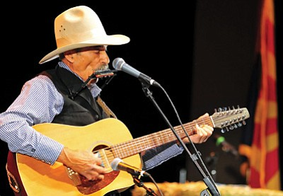 Sid Hausman performs for the crowd at the 2013 Arizona Cowboy Poets Gathering at the Yavapai College Performance Hall in Prescott.  This year's event runs Aug. 7-9.<br> Matt Hinshaw, file/The Daily Courier