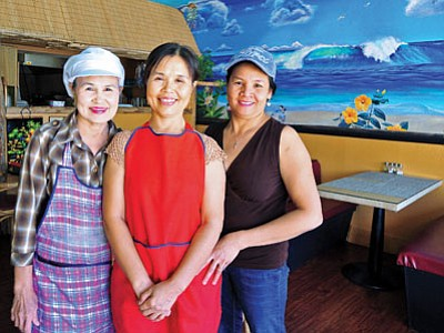 Akaga Bernard, center, co-owner of Dee Thai Express, stands with fellow co-owner Jane Buaket, right, and Bernard's sister Nady Noensathan. Dee Thai Express opened their doors on West Sheldon Street on July 14. (Matt Hinshaw/The Daily Courier)