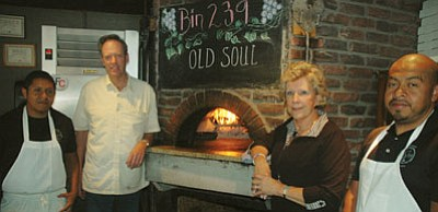 Bin 239 owners Kelly and Karen Keller with chefs Andy and Ricky Garcia. (Patrick Whitehurst/The Daily Courier)