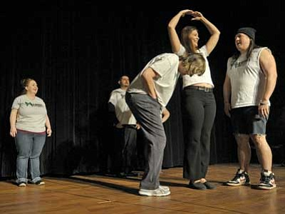 Matt Hinshaw/The Daily Courier<br> The cast of the Mile High Comedy Theater rehearses Wednesday evening at the Elks Theater in Prescott.  The improv comedy group will have its first performance of 2015 at 7 p.m. today, Jan. 23, at the Elks.