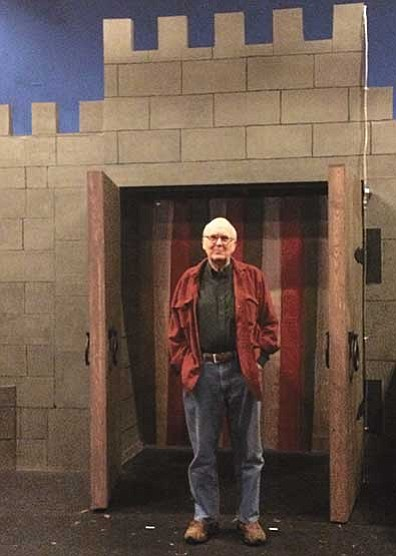 "Jason Wheeler/The Daily Courier<br> Director Bruce Lanning stands under the set for ""Spamalot."""