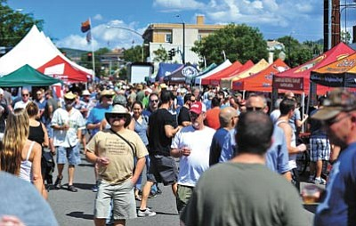 People fill Goodwin Street during the 2014 Mile High Brewfest in downtown Prescott. Brewers from all over the region brought their signature brews for patrons to sample. This year's event will be on Cortez Street on Saturday, June 20. (Matt Hinshaw/The Daily Courier, file)