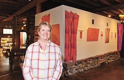 Cindy Gresser, executive director of the Smoki Museum in Prescott, stands near the museum's newest exhibit Wednesday morning. (Matt Hinshaw/The Daily Courier)