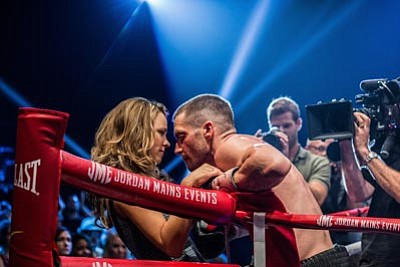 "Rachel McAdams, left, as Maureen Hope and Jake Gyllenhaal as Billy Hope, in the film, ""Southpaw.""  The movie releases in the U.S. on July 24, 2015. (Scott Garfield/The Weinstein Company via AP)"