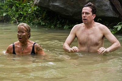 """Christina Applegate, left, as Debbie Griswold, and Ed Helms as Rusty Griswold, in a scene from New Line Cinema's comedy """"Vacation."""" (Warner Bros. Pictures)"""