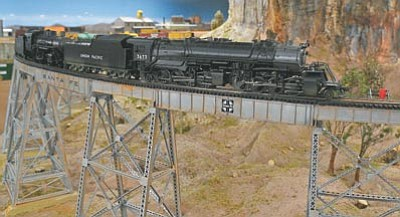 An HO scale model train weaves its way through Jim Hanna's tri-level track in September 2012. The Beat The Heat Model Train swap meet in Prescott Valley will take place on Aug. 15, 2015, at Liberty Traditional School. (Matt Hinshaw, file/The Daily Courier)