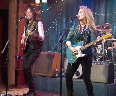 "Rick Springfield, left, as Greg and Meryl Streep, as Ricki, perform at the Flash at the Salt Well in TriStar Pictures' ""Ricki and the Flash."" The movie opens in U.S. theaters today. (Bob Vergara/Sony Pictures via AP)"