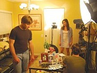 """Andrew Kim/Courtesy<br>PHS graduate Chase Hinton (left) rehearses on the set with Emily Alpren during filming of Hinton's new film, """"Run."""" Hinton stars as """"Mark""""  and Alpren co-stars as """"Katie"""" in the short film about love lost and re-found. The film premieres at 7 p.m. tonight at Summers Dance Works, 843 Miller Valley Rd., in Prescott. The showing is free and open to the public."""