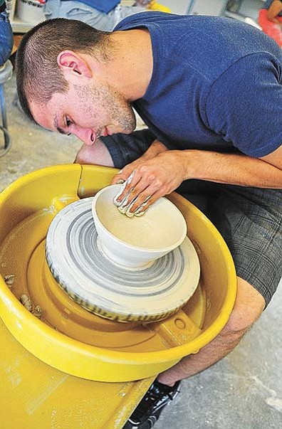 In this file photo, Yavapai College ceramic fire arts major Matthew Kaminski molds a bowl for a previous Empty Bowls event.  Every year, student and volunteer potters come together to fashion bowls to donate to the Empty Bowls event to help feed the hungry.<br /><br /><!-- 1upcrlf2 --><br /><br /><!-- 1upcrlf2 -->(Matt Hinshaw/The Daily Courier)