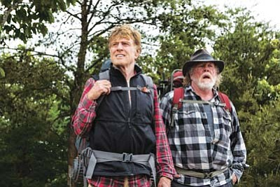 """Robert Redford, left, stars as Bill Bryson and Nick Nolte is Stephen Katz in the film """"A Walk in the Woods."""" The movie opened in U.S. theaters on Sept. 2. (Frank Masi, SMPSP/Broad Green Pictures via AP)"""