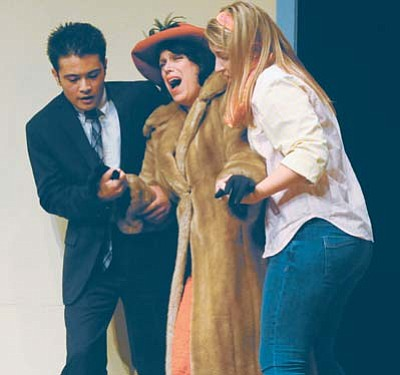 """From left, Julian Jenney as Paul Bratter, Judy Stahl as Ethel Banks and Danielle Plaso as Corie Bratter rehearse a scene from the Prescott Center for the Arts production of """"Barefoot in the Park"""" Monday night. (Les Stukenberg/The Daily Courier)"""