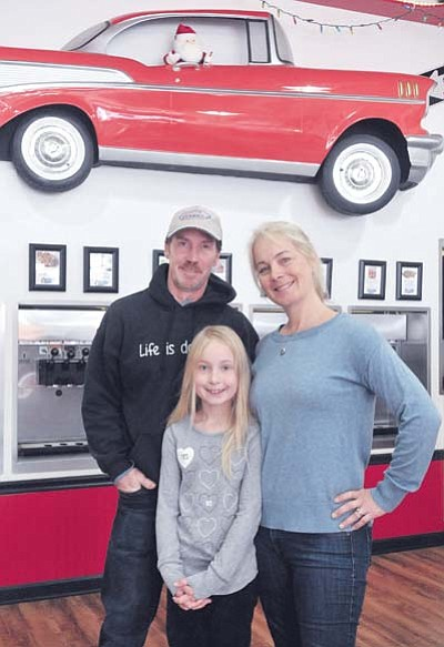 Denise, Matt, and Thea Crotty, 9, owners of Frannie's Yogurt, Ice Cream & Espresso Bar in downtown Prescott, opened their business in 2013.  They sell frozen yogurt, coffee and pastries, among other items. Inset: Homeade scones sold at Frannie's.