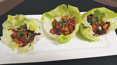 The Lettuce Cups at Augie's Restaurant contain chicken, cashews, and soy-ginger sauce, all served in iceberg lettuce. (Courtesy photo)