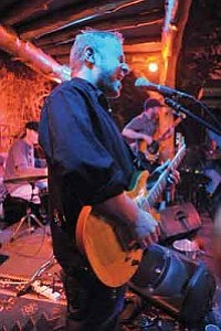 Matt Hinshaw/The Daily Courier<br>Brian Moss lead guitar for Spafford band sets the tone Wednesday night at Coyote Joe's.