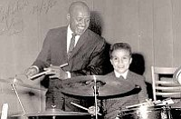 """Frankie Chavez/Courtesy<br>Frankie Chavez and music great Lionel Hampton ham it up on the set of """"West Side Story"""" in this 1960 photograph."""