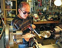 Brett Soldwedel/The Daily Courier<br>Bandhu Dunham has been a glass artist for 35 years and his work is currently displayed at the Prescott College Art Gallery through Nov. 27.