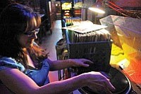 Matt Hinshaw/The Daily Courier<br /><br /><!-- 1upcrlf2 -->Bartender Josie Mendor plays a vinyl record Tuesday night at the Bird Cage Saloon on Whiskey Row. Customers and employees are encouraged to bring in their old records to play during Vinyl Night at the Bird Cage on Tuesdays.