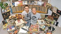 Matt Hinshaw/The Daily Courier<br>Scott Bruner and his son Zach show off part of their 3,000+ vinyl record collection Wednesday night in Prescott.  According to the music industry, sales of vinyl records are up in 2011.