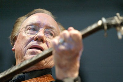 Eric Parsons/The Associated Press<br>In this June 10, 2005 file photo, Earl Scruggs, performs at the Bonnaroo Music & Arts Festival in Manchester, Tenn. Scruggs' son Gary said his father passed away Wednesday morning at a Nashville, Tenn., hospital of natural causes. He was 88.