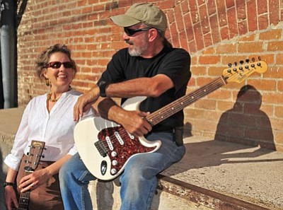 """Matt Hinshaw/The Daily Courier<br> Karuna Fedorschak and Wolfgang Dieterich have been friends since the 80s and recently formed a band called """"Small Change.""""  Their music is based on the lyrics of poet Lee Lozowick."""