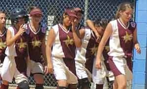 <i>Photo by Jeff Pope</i> <b>The Winslow 11-12-year-old girls1 All-Stars couldn1t hide their disappointment at losing to Peoria in the championship game  on July 22.</b>