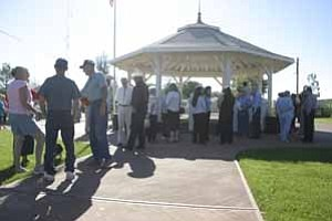 <i>Photo by Jeff Pope</i> <b>Approximately 100 people gathered at the gazebo on First Street and Kinsley on Friday to officially dedicate the Parkway, Phase I of the Renaissance on Route 66 project.