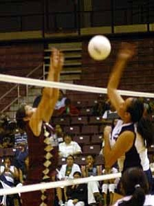 <i>Photo by Jeff Pope</i> <b>The Bulldogs¹ Arveda Yazzie blocks a shot by the Scouts in a loss to to Window Rock on Sept. 6.</b>