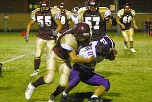 <i>Photo from archives</i><b>Bulldog Mark Armao, shown here in a game against Payson, ran four yards to score and got the two-point converison on a pass from Matt Oso during the state semi-finals game against the Safford Bulldogs last Thursday.</b>