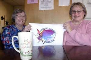 <i>Photo by Jeff Pope</i> <b>This picture of Winslow sisters Ursula Baker (left) and Chris McCoy was taken in early 2005, when the duo first started the Christie¹s Pixie Dust Foundation to support three missions offering shelter and counseling services to the homeless, domestic abuse victims and substance abusers.</b>