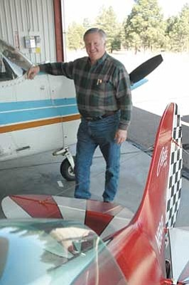 Larry Deibel with his plane at a hangar in Flagstaff