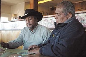 Tommy Dukes (left) meets with Ivan Sidney, former Hopi tribal chairman to discuss a fund-raising country western dance out on the Hopi Reservation to help send Dukes to Memphis for the International Blues Competition.