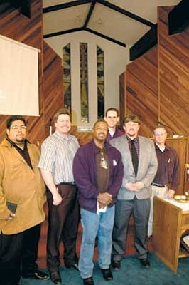Members of the Winslow Ministerial Association presented Glen Mattox, in the front and middle, with the 2006 Good Samaritan Award for his work feeding those in need.