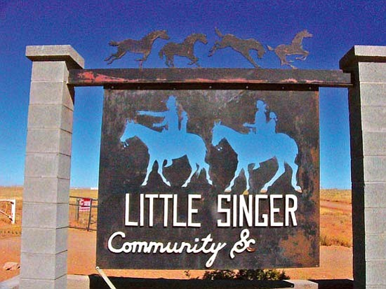 <i>Photo by S.J. Wilson/NHO</i><br> A handmade sign pays tribute to Little Singer Community School.