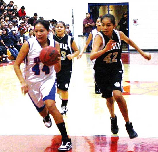 <i>Photo by Anton Wero/NHO</i><br> April Lester (44) of the Holbrook Lady Roadrunners drives full court after a steal. In hot pursuit is Chinle's Tia Dalton (42). The Lady Wildcats eventually won the important contest with a final score of 57 -45.