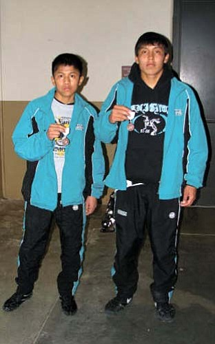 <i>Courtesy photo</i><br> Greyhills Academy sophomore Kevin Tso (left) and senior Garrett Manygoats captured third place wins at the 2009 2A Arizona State Wrestling Championships held in Prescott Valley on Feb. 7. Manygoats, who will be graduating later this spring, finished with a record of 39 wins and 11 losses.