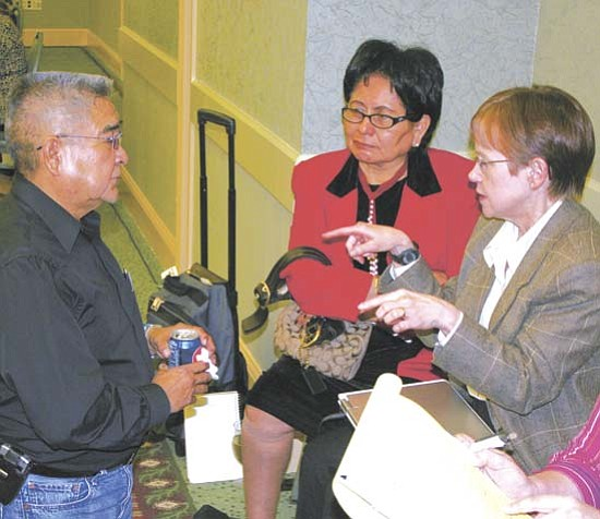 <i>Courtesy photo</i><br> Evelyn Acothley (center), member of Navajo Health and Social Services Committee of the Navajo Nation Council and the National Tribal Leaders Diabetes Committee, consults with Karen Bachman-Carter (right), Nutritionist and Navajo Area Indian Health Service (NAIHS) Consultant, and Robert Nakai during a break at the National Tribal Leaders Diabetes Committee meeting on Feb. 19.