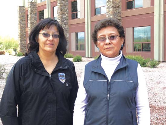 <i>Photo by Rick Abasta</i><br> Brenda Catron (left) and Effie Yazzie are happy to report for the first time that Antelope Canyon Navajo Tribal Park has generated over $1 million in revenue for the 2008 calendar year. The Navajo Parks and Recreation Department is excited with this accomplishment.