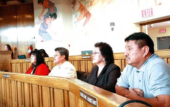 <i>Photo by Joshua Lavar Butler</i><br> Members of the To'Nanees'Dizi Local Government present information about their tax code to the 21st Navajo Nation Council during the 2009 winter session held Jan. 28. The measure, proposing tax increases for the To'Nanees'Dizi Local Government, was tabled at that time for further discussion. Pictured from left to right are Priscilla Littlefoot, Max D. Goldtooth, Helen Herbert and Robert Yazzie.