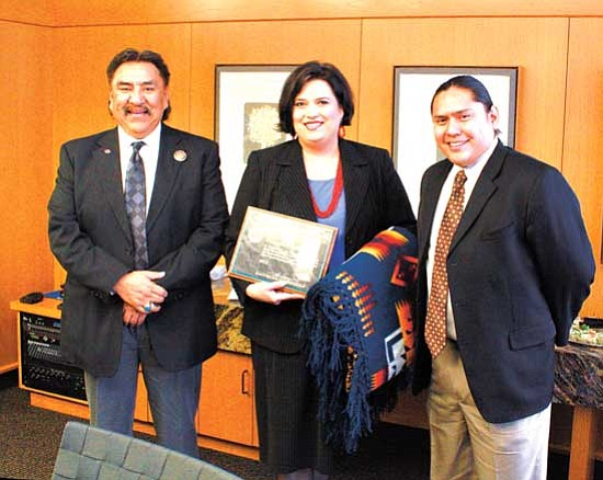 <i>Photo by Joshua Lavar Butler</i><br> Speaker Lawrence T. Morgan (left), Katosha Nakai (center) and legislative staff assistant Eric Descheenie pose for a picture during a recognition gathering for Nakai held March 4 in Phoenix.