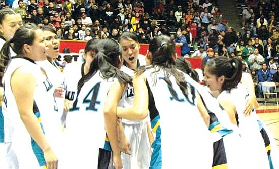 "<i>Photo by Anton Wero/NHO</i><br> The Navajo Prep Lady Eagles celebrate at the conclusion of the 2009 New Mexico First Community Bank 2A Girls State Basketball Championship game held at the University of New Mexico's ""Pit"" arena."