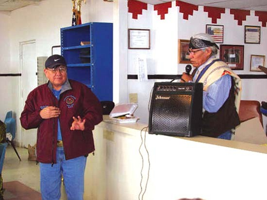 <i>Courtesy photo</i><br> Tonalea Chapter president and school board member Chester Claw makes remarks upon accepting his jacket from Navajo Nation Council Delegate Leslie Dele (Tonalea).