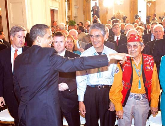 <i>Pete Souza, White House photo</i><br> Navajo Nation President Joe Shirley Jr. and Navajo Code Talker Fank Chee Willeto were guests of President Barack Obama in Washington, D.C. for the signing of the Omnibus Public Lands Management Act of 2009, which authorizes the San Juan River Water Rights Settlement and the construction of the Navajo-Gallup Water Supply Project, an $870 million water delivery system for Navajo communities from Shiprock to Gallup.